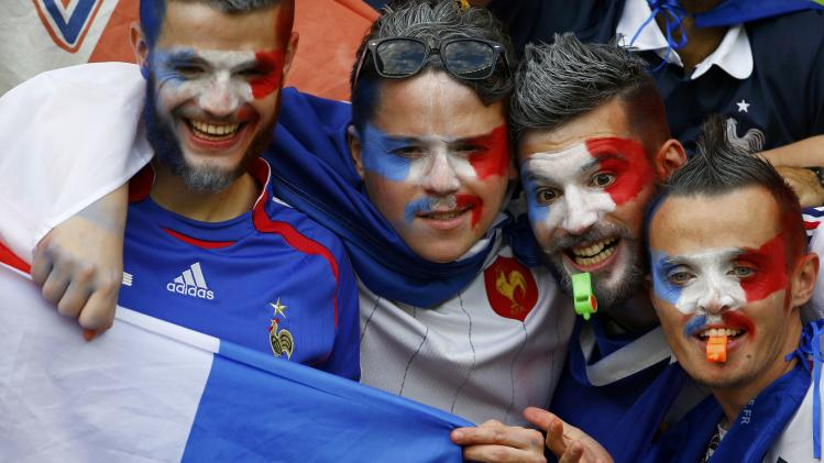 France fans pose before the 2014 World Cup Group E soccer match between France and Honduras at the Beira Rio stadium