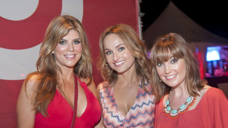 IMAGE DISTRIBUTED FOR TARGET - From left, Ana Quincoces, celebrity chef Giada De Laurentiis, and Dustee Jenkins, Target's vice president of Public Relations, enjoy A Red Hot Night: Presented by Target at the South Beach Wine & Food Festival on Saturday, Feb. 23, 2013 in Miami Beach, Florida. (Mitchell Zachs/AP Images for Target)