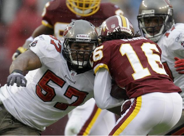 In this Dec. 12, 2010 file photo, Tampa Bay Buccaneers linebacker Adam Hayward (57) tackles Washington Redskins wide receiver Brandon Banks (16) during the first half of an NFL football game in Landov