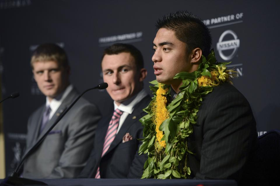 Heisman Trophy finalists, from right, Manti Te'o, of Notre Dame; Johnny Manziel, of Texas A&M; and Collin Klein, of Kansas State, attend a news conference prior to the announcement of the trophy winner, Saturday, Dec. 8, 2012, in New York. (AP Photo/Henny Ray Abrams)