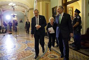 Senate Majority Leader Sen. Harry Reid, D-Nev., left, …