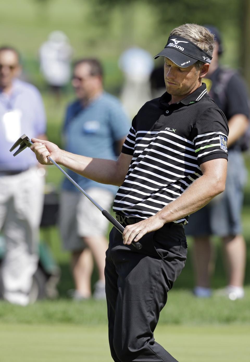 Luke Donald, from England, reacts after missing a short putt for birdie on the 10th hole during the first round of the Bridgestone Invitational golf tournament Thursday, Aug. 1, 2013 at Firestone Country Club in Akron, Ohio. (AP Photo/Mark Duncan)