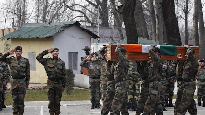 Indian Army soldiers carry a coffin of Indian army officer Col. M.N. Rai who was killed in a gunbattle Tuesday, at an army base in Srinagar, India, Wednesday, Jan. 28, 2015. A brief gunbattle between Indian government forces and suspected rebels on Tuesday killed two rebels and two troops in the disputed Kashmir region, police said. (AP Photo/Dar Yasin)