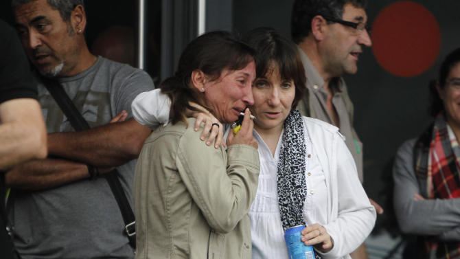 Relatives of victims involved in a train accident wait for news at a victims information point in Santiago de Compostela, Spain, on Thursday July 25, 2013. The death toll in a passenger train crash in northwestern Spain rose to 77 on Thursday after the train jumped the tracks on a curvy stretch just before arriving in the northwestern shrine city of Santiago de Compostela, a judicial official said. (AP Photo/Salome Montes)