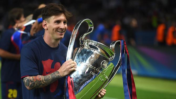 Barcelona s argentinian forward lionel messi holds the trophy after