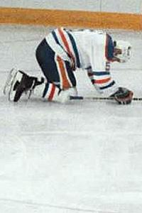 Edmonton Oilers' Steve Smith reacts after scoring a goal into his own net against the rival Calgary Flames in the 1986 NHL playoffs