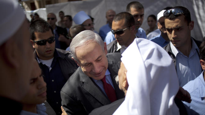 "Israel's Prime Minister Benjamin Netanyahu, center, is welcomed by Druse leaders for the holiday of Nabi Shoaib, the Prophet Jethro, during a cultural event with members of the country's Druse minority in the Druse village of Julis, northern Israel, Thursday, April 25, 2013. Israel shot down a drone Thursday as it approached the country's northern coast, the military said. Suspicion immediately fell on the Hezbollah militant group in Lebanon. The incident was likely to raise already heightened tensions between Israel and Hezbollah, a bitter enemy that battled Israel to a stalemate during a monthlong war in 2006. Prime Minister Benjamin Netanyahu, who was in northern Israel at the time of the incident, said he viewed the infiltration attempt with ""utmost gravity."" (AP Photo/Ariel Schalit)"