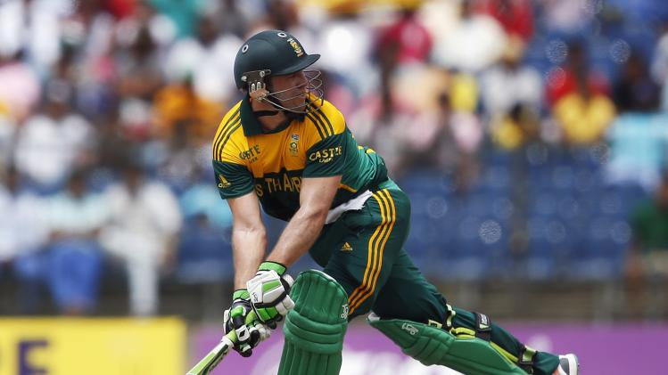 South Africa's captain de Villiers looks back after failing to hit a shot during their final One Day International cricket match against Sri Lanka in Hambantota