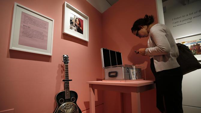 """A guitar that used to belong to Amy Winehouse is seen at an exhibition entitled """"Amy Winehouse: A Family Portrait"""" in London's Jewish Museum, Tuesday, July 2, 2013. The exhibition aims to reveal an intimate side of the late soul diva. She was, in the words of her older brother Alex, """"simply a little Jewish kid from North London with a big talent."""" It includes a trove of items from the singer's London childhood, her stage-school years and her short but stratospheric career in music _ from her first guitar to a posthumous Grammy Award. By the time she died in 2011 at the age of 27, Winehouse was a star, a larger-than-life figure whose battles with drugs and alcohol, splashed across front pages around world, sometimes seemed to overshadow her talent. (AP Photo/Lefteris Pitarakis)"""