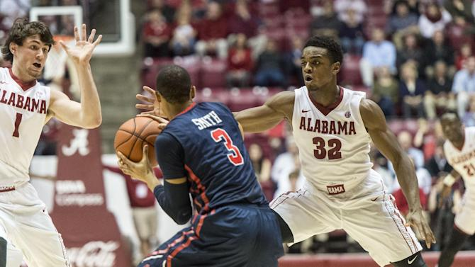 Alabama guard Retin Obasohan (32) and teammate Riley Norris (1) defend Mississippi guard Terence Smith (3) during an NCAA college basketball game Tuesday, March 3, 2015, in Tuscaloosa, Ala. Mississippi won 82-74. (AP Photo/AL.com, Vasha Hunt)