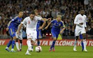 Frank Lampard of England scores a goal from the penalty spot during the 2014 World Cup qualifying football match against Ukraine at Wembley Stadium in north London, England. The game finished 1-1