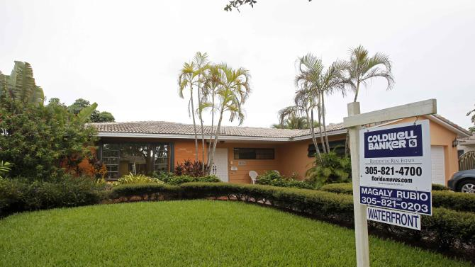 In this Thursday, Sept. 27, 2012 photo, a home for sale is shown in Miami Lakes, Fla. Average U.S. rates on fixed mortgages fell to fresh record lows for the second straight week. The declines suggest the Federal Reserve's stimulus efforts are having an impact. (AP Photo/Alan Diaz)