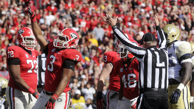 Georgia running back Todd Gurley (3) reacts after scoring a touchdown against Georgia Tech during the first quarter of an NCAA college football game, Saturday, Nov. 24, 2012, in Athens, Ga. (AP Photo/John Amis)