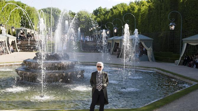 German fashion designer Karl lagerfeld  poses at the end of Chanel's show in the Chateau de Versailles, southwest of Paris, Monday, May, 14, 2012. Master of Fashion, Karl Lagerfeld spares no expenses for his  midseason Chanel Cruise show offering held at the former home of Marie Antoinette. (AP Photo/Jacques Brinon)