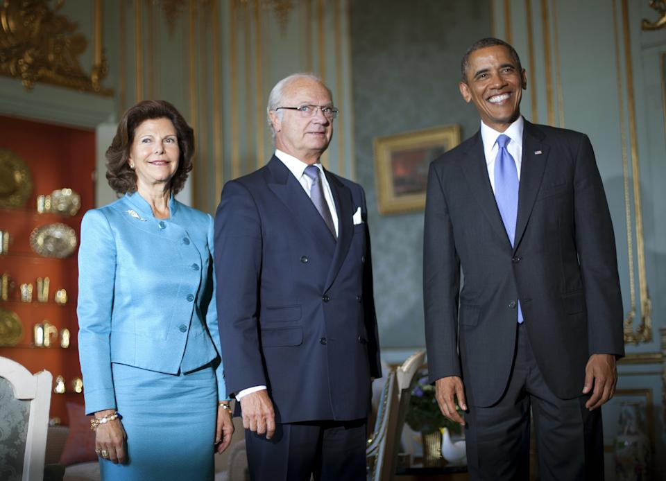 U.S. President Barack Obama, right, meets with Swedish King Carl XVI Gustaf, center, and Queen Silvia at the Royal Palace, Thursday, Sept. 5, 2013, in Stockholm, Sweden. (AP Photo/Pablo Martinez Monsivais)