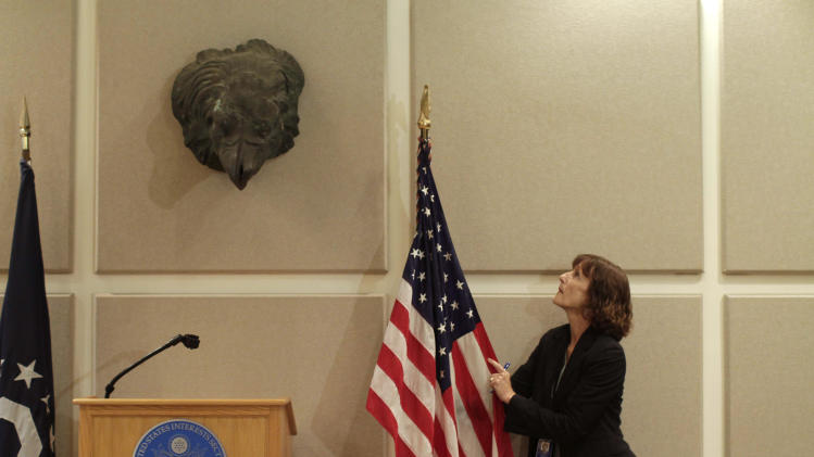 In this Monday, Feb. 4, 2013 photo, the statue of the head of an eagle hangs in a conference room at the U.S. Interests Section in Havana, Cuba. Following the doomed, U.S.-backed Bay of Pigs invasion, a more than 3-ton eagle statue was ripped from the USS Main monument during an anti-American protest and splintered into pieces. The Maine eagle's head was mysteriously delivered to Swiss diplomats, who had agreed to act as protectors of U.S. property in Cuba. Today it hangs in this conference room at the U.S. Interests Section, which Washington maintains in Havana instead of an embassy. (AP Photo/Franklin Reyes)