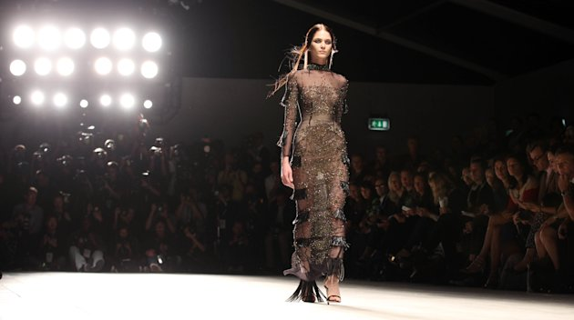 A model wears a creation from Marios Schwab, during London Fashion Week, Sunday, Sept. 16, 2012. (AP Photo/PA, Lewis Whyld) UNITED KINGDOM OUT