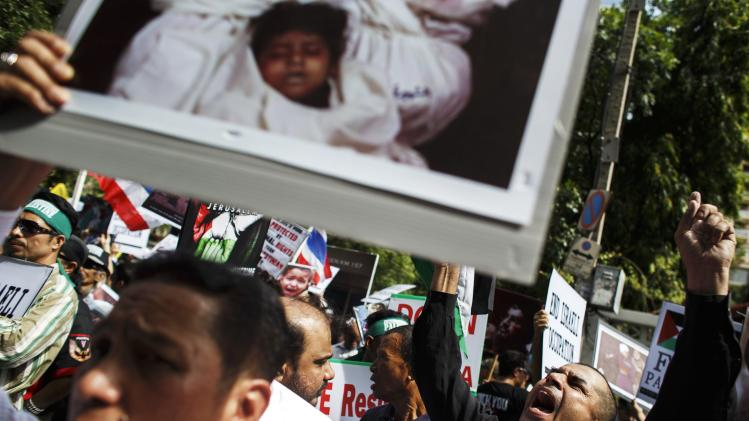 Demonstrators hold banners during an anti-Israel protest, in front of the Israeli embassy, in Bangkok