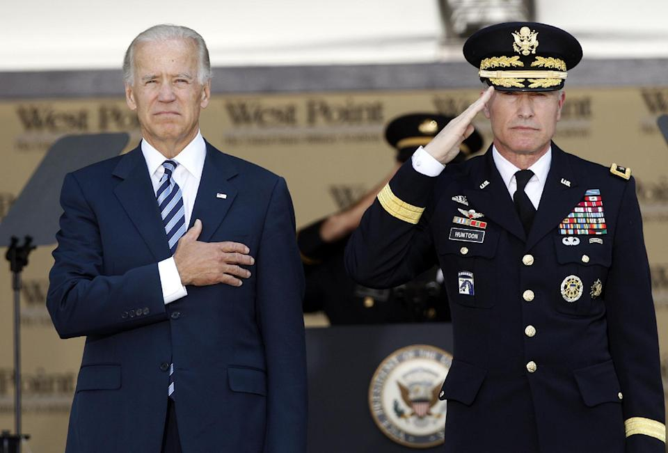Vice President Joe Biden, left, and Lt. Gen. David Huntoon, Jr., superintendent of the U.S. Military Academy stand during the national anthem before a graduation and commissioning ceremony at the in West Point, N.Y., Saturday, May 26, 2012. (AP Photo/Mike Groll)