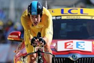 Britain&#39;s Bradley Wiggins, stage winner and overall leader&#39;s yellow jersey, at the end of the 41.5 km Tour de France solo race on July 9. Wiggins tightened his grip on the yellow jersey with a maiden Tour de France stage victory that heaped the pressure on defending champion Cadel Evans