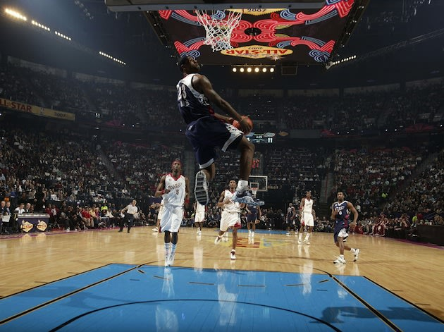 LeBron James throws down a reverse jam in a past All-Star game — Getty Images