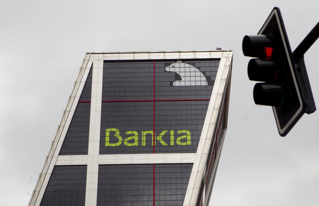 "The Bankia bank headquarters is seen in Madrid, Monday May 7, 2012. Spain's prime minister said Monday the government will likely present important bank clean-up measures this week to clear up doubts about the solvency of the sector, a key source of worry over whether Spain might need a bailout. Rajoy's comments came after El Pais newspaper said the government was preparing to help out troubled lender Bankia SA. Spain's real estate bubble burst in 2008, saddling banks with enormous amounts of bad loans as unemployment rose and people could not pay their mortgages. The Bank of Spain says the sector has about 175 billion euros ($230 billion) in ""problematic"" holdings. Bankia is known to be among the worst hit. (AP Photo/Paul White)"