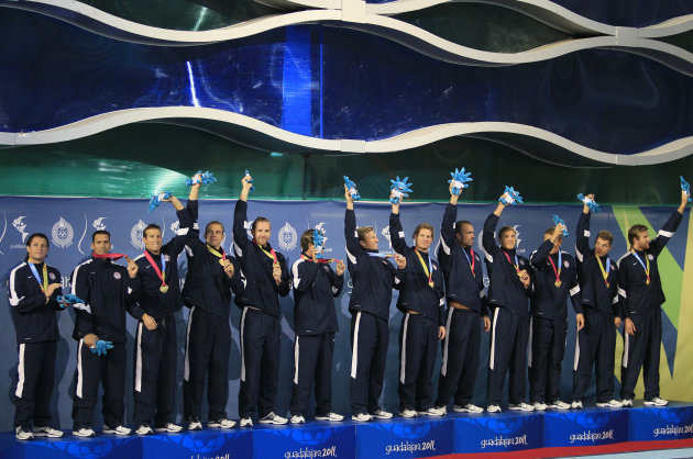 Members of the United States men's waterpolo team wear their gold medals as the celebrate on the podium at the Pan American Games in Guadalajara, Mexico, Saturday Oct. 29, 2011. (AP Photo/Ariana Cubil