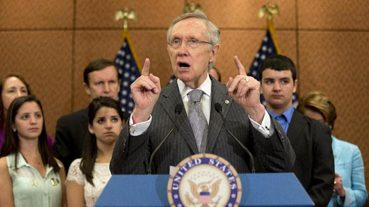 Senate Majority Leader Harry Reid of Nev., accompanied by families and friends of the Newtown, Conn. shooting victims, including siblings of Victoria Soto, Jillian Soto, left, Carlee Soto, and Carlos Soto, gestures as he speaks during a news conference on Capitol Hill in Washington, Thursday, June 13, 2013, on the six month anniversary of the Newtown shooting. (AP Photo/Jacquelyn Martin)