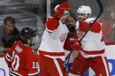 Red Wings' Smith celebrates his goal with teammate Zetterberg as Blackhawks' Sharp skates past during Game 2 of their NHL Western Conference semi-final playoff hockey game in Chicago