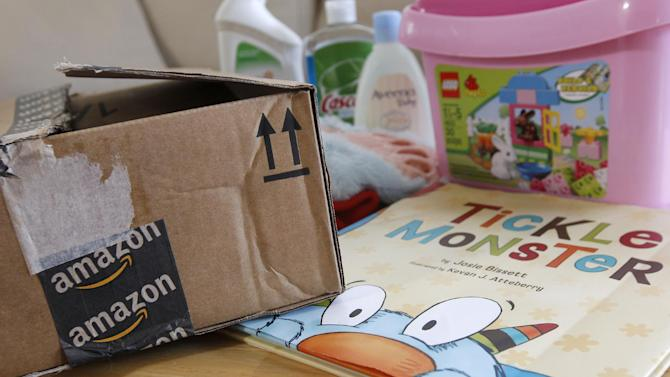 Recent online purchases by Reid Butler from Amazon are shown at his home in Walnut Creek, Calif., Thursday, Sept. 13, 2012. Products are flying off the shelves at Amazon warehouses across the county as Californians prepare to start paying sales taxes on online purchases. (AP Photo/Jeff Chiu)