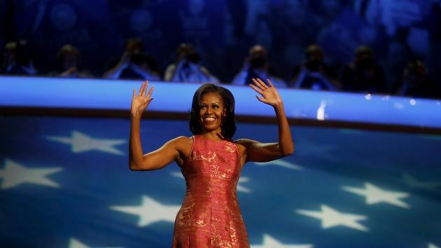 First Lady Michelle Obama waves before speaking at the Democratic National Convention (DNC) in Charlotte, North Carolina, U.S., Sept. 4, 2012 -- Getty Images