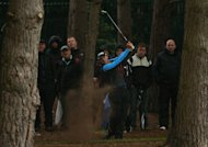 England's Paul Streeter plays out of the woodland area during Day Two of the 2013 BMW PGA Championship, at Wentworth Golf Club.
