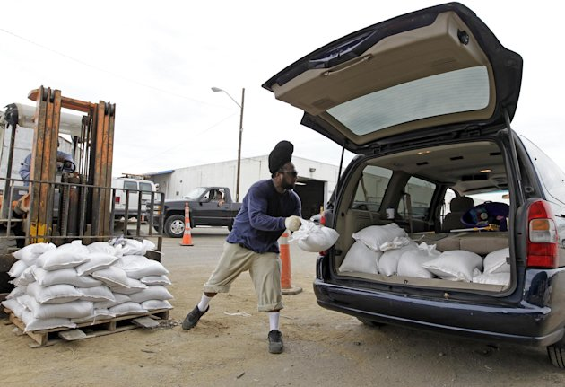 Indianapolis Department of Public Works employee Toraine Briggs loads sandbags into a van in Indianapolis, Friday, Aug. 31, 2012. Hundreds lined up to take advantage of free sandbags as they prepare for heavy rains expected as slow-moving Isaac makes its way north and east.(AP Photo/Michael Conroy)
