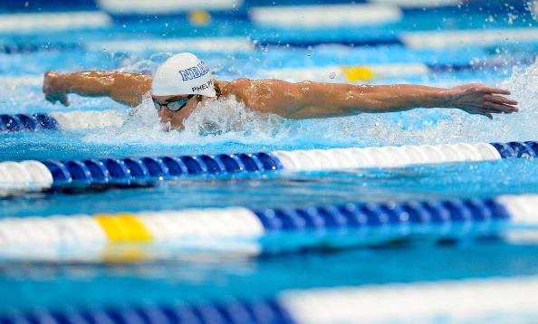 Michael Phelps competes in the championship final of the Men's 100 m Butterfly during Day Six of the 2012 U.S. Olympic Swimming Team Trials at CenturyLink Center on July 1, 2012 in Omaha, Nebraska. (Photo by Jamie Squire/Getty Images)