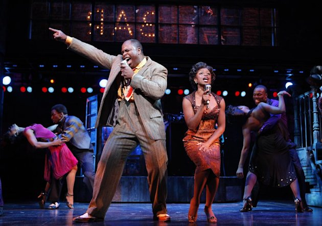 "This theater image released by The Hartman Group shows J. Bernard Calloway, left, and Montego Glover in a scene from the musical ""Memphis."" Producers said Tuesday, June 26, 2012, that the Joe DiPietro-written musical will play its last performance on Aug. 5 after 30 previews and 1,166 regular performances. It opened in October 2009. (AP Photo/The Hartman Group, Joan Marcus)"