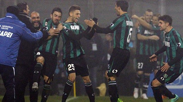 Sassuolo's Domenico Berardi (25) celebrates after scoring their fourth goal against AC Milan during their Italian Serie A soccer match at the Mapei stadium in Reggio Emilia (Reuters)