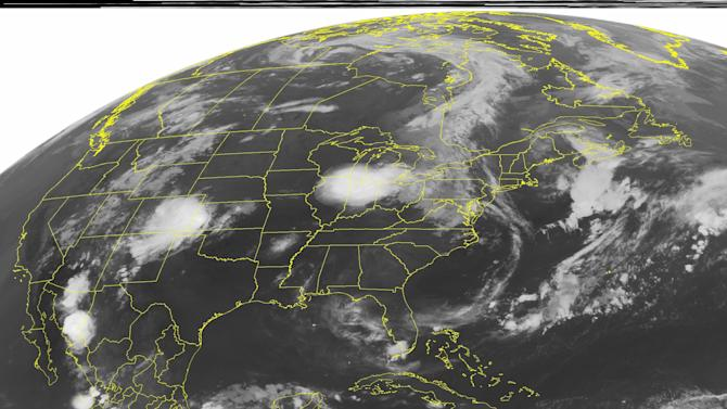 This NOAA satellite image taken Wednesday, Aug. 3, 2011 at 1:45 a.m. EDT shows cloud cover in the Great Lakes region as well as the High Plains where both regions continue to see rain fall into the night.  In the Caribbean, tropical storm Emily pushes northeastward towards Hispaniola. (AP PHOTO/WEATHER UNDERGROUND)