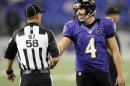 Side judge Jimmy DeBell (58) shakes hands with Baltimore Ravens punter Sam Koch (4) before an NFL football game against the Cleveland Browns in Baltimore, Thursday, Sept. 27, 2012. (AP Photo/Nick Wass)