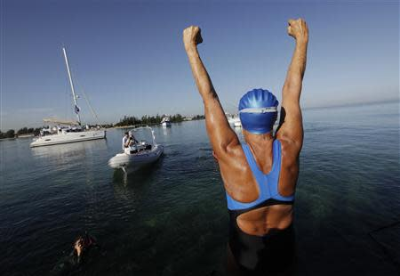 U.S. long-distance swimmer Diana Nyad cheers before attempting to swim to Florida from Havana