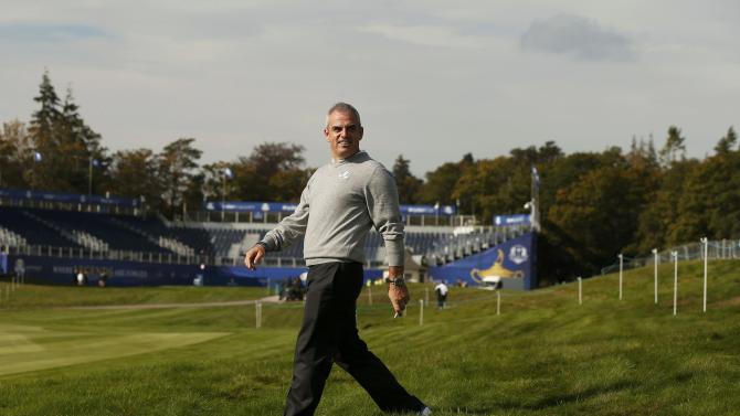 Europe Ryder Cup captain Paul McGinley walks in the rough during practice ahead of the 2014 Ryder Cup at Gleneagles in Scotland