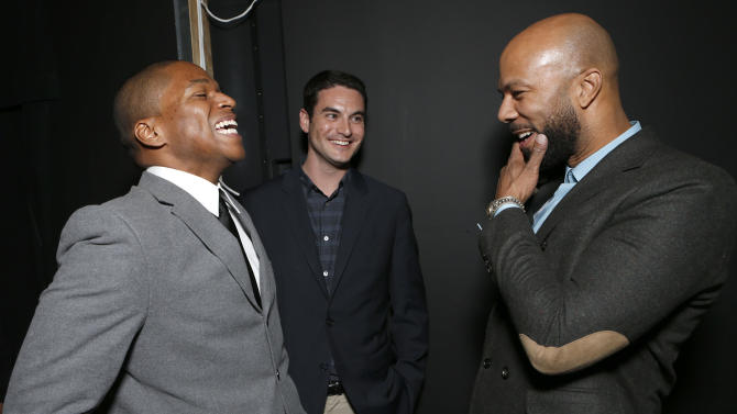"""Director Sheldon Candis, Producer Jason Michael Berman and Common attend the LA premiere of """"Luv"""" at the Pacific Design Center on Thursday, Jan. 10, 2013, in West Hollywood, California. (Photo by Todd Williamson/Invision/AP)"""