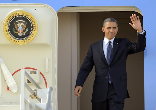 President Barack Obama waves as he arrives at Los Angeles International Airport, Thursday, May 10, 2012, in Los Angeles. Obama is traveling to the West Coast for a series of campaign fundraisers. (AP Photo/Mark J. Terrill)