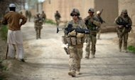 German soldiers walk along the banks of a river during a patrol in Kunduz in March 2012. NATO allies sought Wednesday to ensure a smooth withdrawal from Afghanistan and reassure Kabul that the West would financially back Afghan forces once foreign combat troops are gone in 2014