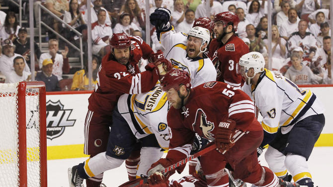 As Phoenix Coyotes' Derek Morris (53) tries to get the puck, Nashville Predators' Andrei Kostitsyn (46), of Russia, celebrates his goal while Coyotes' Daymond Langkow (22), Keith Yandle (3), Predators' Nick Spaling (13) and Patric Hornqvist, of Sweden, battle in front of Coyotes goalie Mike Smith during the second period of Game 1 in an NHL hockey Stanley Cup Western Conference semifinal playoff series, Friday, April 27, 2012, in Glendale, Ariz. (AP Photo/Ross D. Franklin)