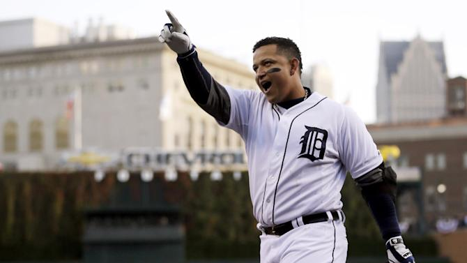Oct. 18, 2012, file photo, Detroit Tigers' Miguel Cabrera celebrates after hitting a two-run home run during the fourth inning of Game 4 of the American League championship series against the New York Yankees in Detroit. Cabrera and Mike Trout are the top contenders for the American League Most Valuable Player award, to be announced Thursday, Nov. 15, 2012. (AP Photo/Matt Slocum, File)