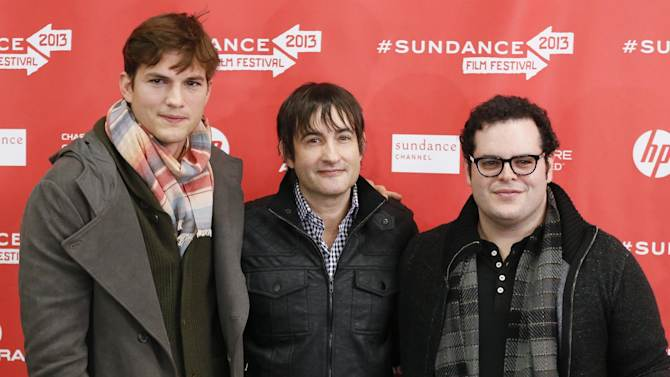 "From left, actor Ashton Kutcher, who portrays Steve Jobs, director Joshua Michael Stern, and actor Josh Gad, who portrays Steve Wozniak, pose together at the premiere of ""jOBS"" during the 2013 Sundance Film Festival on Friday, Jan. 25, 2013 in Park City, Utah. (Photo by Danny Moloshok/Invision/AP)"