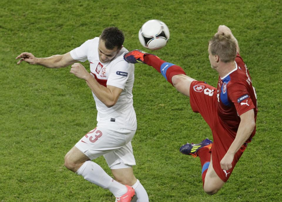 Poland's Pawel Brozek, left, and Czech Republic's David Limbersky fight for the  ball during the Euro 2012 soccer championship Group A match between Czech Republic and Poland in Wroclaw, Poland, Saturday, June 16, 2012. (AP Photo/Antonio Calanni)
