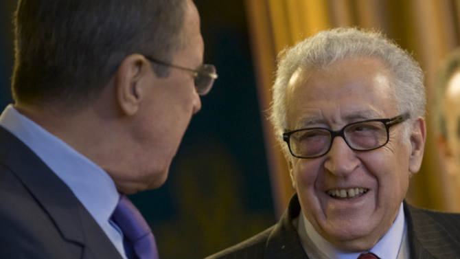 Russian Foreign Minister Sergey Lavrov, left, and U.N. envoy for Syria Lakhdar Brahimi meet in Moscow, Russia, on Saturday, Dec. 29, 2012. (AP Photo/Ivan Sekretarev)