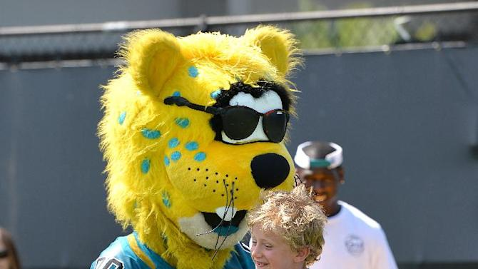 Luke Harmon, tries to run through Jaxon de Ville after catching a pass at an NFL football Jacksonville Jaguars' Got Skills Rookie Day on Friday, June 20, 2014, in Jacksonville, Fla