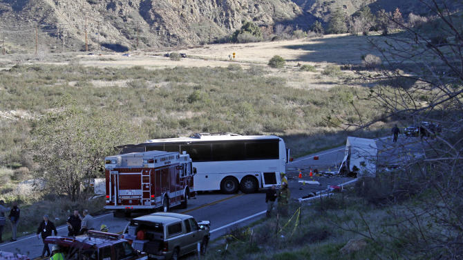 Authorities continue their investigation of the scene where at least eight people were killed and 38 were injured after a tour bus carrying a group from Tijuana, Mexico crashed with two other vehicles just north of Yucaipa, Calif., Sunday, Feb. 3, 2013. (AP Photo/Reed Saxon)